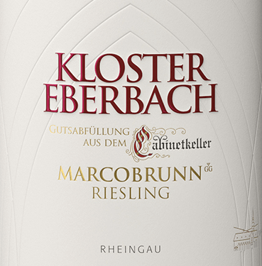 """With the Erbacher Marcobrunn Riesling Großes Gewächs from Kloster Eberbach, the winery ties in with the centuries-old tradition of cabinet cellar wines. A tradition that goes back to the Eberbach Cistern Monks, who in the 12th century carried the demanding Burgundian vine from their homeland, Burgundy, and cultivated it in the Rheingau. The Eberbach Erbacher Marcobrunn Riesling sparkles in a light straw yellow with golden highlights in the glass. The complex bouquet of this expressive white wine reveals a wonderful aroma of ripe apples, juicy mangoes and pears. Add some passion fruit and subtle woody notes. On the palate, this German white wine has a powerful, gripping body with notes of apples, pears, tropical fruits and a filigree wood insert. The acid is perfectly woven into the body and is supported by a good tension. The finale comes with magnificent length and elegance. Vinification of Eberbach Riesling Großes Gewächs Erbacher Marcobrunn A document dated 1390 proves that the vineyard in """"Marckinborn"""" is one of the oldest monastic vineyards. The name Marcobrunn is derived from the fountain that stands between Hattenheim and Erbach. The location was considered synonymous with the finest Rheingau wines in 1762. This position is oriented to the south with an inclination of 0% to 25%. The deep soils are rich in clayey marl and calcareous. After the very careful harvesting of the grapes we prepared the harvested material in the cabin cellar for fermentation. After strict selection, the fermentation process begins in stainless steel tanks. At maturity, this wine is placed in wooden barrels for some time and rests a little further on the bottle. Food recommendation for the Erbacher Marcobrunn Riesling Kloster Eberbach Großes Gewächs Enjoy this expressive, dry white wine from Germany with fresh fish in a herbal lemon coat and all kinds of asparagus dishes. A great wine for special occasions - also like to drink solo."""