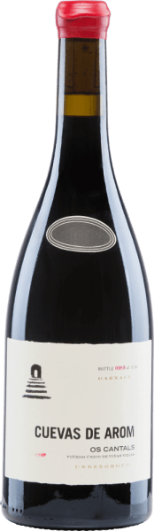 The Os Cantals from Cuevas de Arom is an excellent, multi-layered red wine from the Garnacha Tinta grape variety (100%). This red wine is grown in the Spanish D.O. Campo de Borja in Aragon. In the glass, this Spanish wine sparkles in a medium garnet red with light red highlights. The aromatic bouquet has a complex variety of aromas. The nose enjoys juicy cherries, plums and ripe raspberries with hints of fresh liquorice and fennel. The spicy secondary notes reveal black pepper, clove and finely smoky nuances. The well-structured body presents a powerful personality that goes hand in hand with supple, ripe tannin and a firm acidic structure. This Spanish red wine convinces with finesse, elegance and a long, present finale. Vinification of Cuevas de AromOs Cantals The Garnacha grapes for this complex red wine grow at an altitude of 500-600 m in a flat position on vines over 25 years old. The soils are rich in iron, lime and rock. The growth of the grapes is favoured bythe continental climate with a slight Mediterranean influence. The harvest and also the selection of the grapes is done carefully by hand. After gentle and gentle pressing of the harvested material, the resulting mash is fermented in cement tanks at a controlled temperature. After this completed fermentation process, this wine matures for 10 months in French oak wooden barrels. Finally, this red wine is lightly filtered and poured onto the bottle. Food recommendation for the Os Cantals of Cuevas de Arom This dry red wine from Spain should simply be enjoyed solo for cosy evenings. Decant this wine early so that the entire flavour spectrum can unfold. Os Cantals Decanter Awards: 94 points for 2015 Guía Peñín: 91 points for 2015 The Wine Advocate: 92 points for 2015