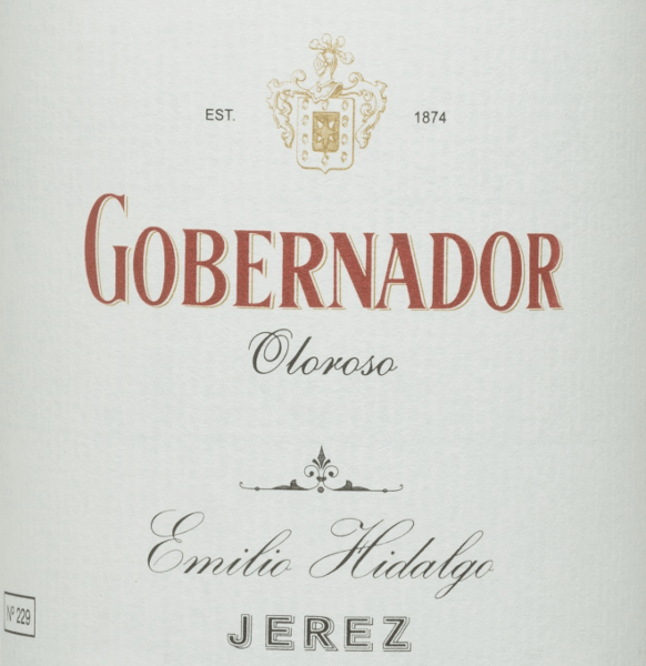 The Gobernador Oloroso by Emilio Hidalgo is a sherry from the Spanish wine region D.O. Jerez, aged for many years.  A bright mahogany colour shines in the glass. This noble sherry convinces the nose as well as the palate with its strong nutty aromas - walnuts, hazelnuts and almonds. On the palate, this Spanish wine convinces with its full-bodied and dry character and a long-lasting reverberation.  Vinification of Hidalgo Gobernador Oloroso The grapes harvested by hand are destemmed, gently pressed and the must produced therefrom fermented in a temperature-controlled manner in a stainless steel tank. The young wine is then drawn off, sprayed on and placed in American oak barrels for the first ripening. The barrels are filled only to a certain extent (maximum 85%), so that the characteristic pile (a yeast layer) can develop, which seals the wine airtight and gives it the sherry-specific aroma. After maturation, the wine is transferred to the traditional Solera system, in which sherries of the same type are aged in barrels arranged one above the other. The oldest wines are stored in the lower barrels (Solera), while the youngest wines are stored in the upper rows (Criaderas). The sherry intended for sale is always removed from the lower barrels. In this case, however, only a small part (a maximum of one third) is removed and the removed part is then filled up by sherry from the upper rows. The whole principle continues to the uppermost barrels, where young wine, the Mosto, is added to the sherry. In the Solera, the amontillado loses its pile and the oxidative ripening process begins. During this phase, it develops its aromatic fullness and strong color. Food recommendation for  Gobernador Oloroso Emilio Hidalgo This dry sherry from Spain goes best chilled as an aperitif. But this wine  is also a treat for  spicy, refined meat dishes.