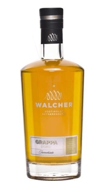 The Grappa d 'Oro Riserva by Walcher captivates with its harmonious interplay of noble wood notes, vanilla and fresh fruit nuances. This grappa from South Tyrol is round and harmonious. The Walcher distillery is located near Bolzano, where a mild and Mediterranean climate prevails. Summers are hot and winters mild, which means optimal conditions for fruit trees to produce fully ripe fruits. Production of the Grappa d´Oro Riserva This grappa is expertly distilled in the traditional grape separation bubbles and then matures in barrique barrels and thus becomes a mild and fine marc fire. Serving recommendation for the Grappa d 'Oro Riserva Enjoy this grappa pure, for example as a digestif at a temperature of 8 ° Celsius.