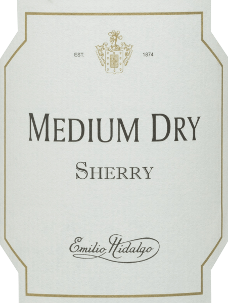 Emilio Hidalgo's Medium Dry is an amber semi-dry sherry made from Palomino (93%) and Pedro Ximénez (7%) grapes. In the nose, this sherry pampers with an elegant bouquet of plums, almonds, walnuts and honey as well as some caramel. This wine flatters the palate with an elegant, mild taste of almonds and hazelnuts, which has a subtle residual sweetness. This is a complex and diverse sherry with a delicately spicy, long finish. Vinification of Hidalgo Medium Dry The grapes harvested by hand are destemmed, gently pressed and the must produced therefrom is fermented in a temperature-controlled manner in a stainless steel tank. The young wine is then drawn off, sprayed on and placed in American oak barrels for the first ripening. The barrels are filled only to a certain extent (maximum 85%), so that the characteristic pile (a yeast layer) can develop, which seals the wine airtight and gives it the sherry-specific aroma. After maturation, the wine is transferred to the traditional Solera system, in which sherries of the same type are aged in barrels arranged one above the other. The oldest wines are stored in the lower barrels (Solera), while the youngest wines are stored in the upper rows (Criaderas). The sherry intended for sale is always removed from the lower barrels. In this case, however, only a small part (a maximum of one third) is removed and the removed part is then filled up by sherry from the upper rows. The whole principle continues to the uppermost barrels, where young wine, the Mosto, is added to the sherry. In the Solera, the amontillado loses its pile and the oxidative ripening process begins. During this phase, it develops its aromatic fullness and strong color. Food recommendation for  the medium Dry Emilio Hidalgo This semi-dry sherry is easy to enjoy chilled as an animating aperitif, but can also be combined with appetizers such as an artichoke omelette or mushrooms with chorizo in a versatile and enjoyable way.