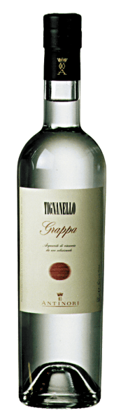 The grappa Tignanello by Marchesi Antinori shines crystal clear, on the nose the typical aromas of the Sangiovese and Cabernet grapes, on the palate soft, warm, fruity, with a long, pleasant finish. Production of the grappa Tignanello by Marchesi Antinori This fine and aromatic grappa is distilled from the marc of the grapes harvested from the vineyard Tignanello for the wine of the same name. The fermented marc is distilled immediately after removal of the wine from the containers and the corresponding pressing of the grapes. As a result, only the highest quality pomace is used, rich in alcohol and above all in aromatic ingredients. Of the grappa distilled from the various pomace batches, only the best, finest and most aromatic distillates are ground and bottled as grappa Tignanello.Grappa Tignanello is available in limited quantities. Serving recommendations for the Grappa Tignanello by Marchesi Antinori Enjoy this fine Tignanello grappa as a digestif after a nice meal, for Christmas or for a special occasion, possibly even as a crowning conclusion after a meal accompanied by Tignanello.
