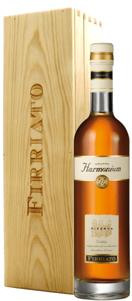 """This uniquely soft grappa is made from the marc of the award-winning Nero d 'Avola """"Harmonium"""".The Grappa Harmonium Riserva by Firriato captivates with its aromatic fragrance with nuances of vanilla, plum, almond and clove, which is rounded off by pleasantly smoky notes. In a wine glass or cognac swivel, this grappa is best enjoyed as it can unfold its full aroma."""