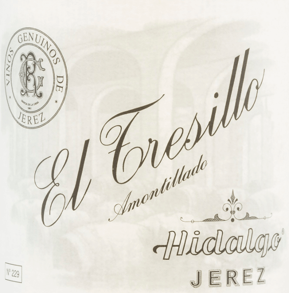El Tresillo Amontillado by Emilio Hidalgo from the sherry cultivation area D.O. Jerez in Andalusia, is vinified exclusively from Palomino Fino grapes. A clear mahogany colour with glittering reflections shimmers in the glass of this sherry. The bouquet convinces with its multifaceted aroma - especially hazelnuts, walnuts and almonds are in the foreground and are accompanied by spicy notes. On the palate, this sherry presents itself balanced with a present, full-bodied and body-rich character. Even in the long finale, fine-nosed nuances still show up. Vinification of Emilio HidalgoEl Tresillo Amontillado The grapes harvested by hand are destemmed, gently pressed and the must produced therefrom is fermented in a temperature-controlled manner in a stainless steel tank. This young wine is then drawn off, sprayed on and placed in American oak barrels for the first ripening. The barrels are filled only to a certain extent (maximum 85%), so that the characteristic pile (a yeast layer) can develop, which seals the wine airtight and gives it the sherry-specific aroma. After maturation, this wine is transferred to the traditional Solera system, in which sherries of the same type are aged in barrels arranged one above the other for three to ten years. The oldest wines are stored in the lower barrels (Solera), while the youngest wines are stored in the upper rows (Criaderas). The sherry intended for sale is always removed from the lower barrels. In this case, however, only a small part (a maximum of one third) is removed and the removed part is then filled up by sherry from the upper rows. The whole principle continues to the uppermost barrels, where young wine, the Mosto, is added to the sherry. Food recommendation for El Tresillo HidalgoAmontillado This sherry from Spain goes perfectly with dishes with salted meat or with duck roasts with dumplings and blueberry. Awards for El Tresillo Amontillado by Emilio Hidalgo Vinum: 18 points Guía Peñín: 93 points The Wine Advocate: 90 