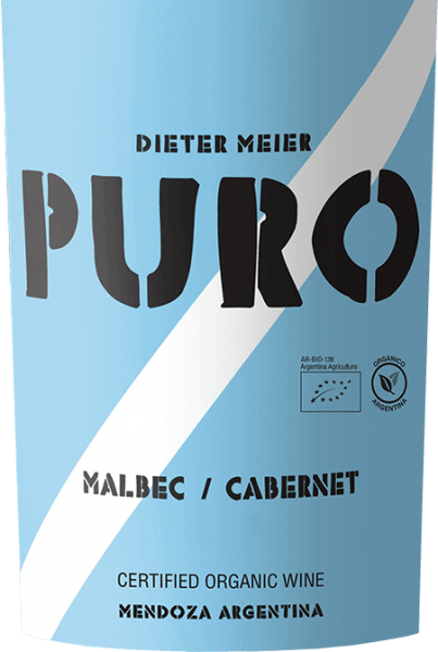 The Puro Malbec Cabernet from Dieter Meier is vinified to 55% Malbec and 45% Cabernet Sauvignon. In the glass, this Argentine red wine shows itself in a strong dark red with ruby-red highlights. The bouquet reveals expressive notes of ripe cherries and juicy plums. The aromas of the nose are also reflected on the palate. This red wine convinces with its full-bodied, juicy and multi-layered character, which is carried by opulent fruit and soft tannins. Vinification of Puro Malbec Cabernet by Dieter Meier The vines of Malbec and Cabernet Sauvignon grow on high vineyards in the Luján de Cuyo wine-growing region of Argentina. The terroir offers the advantage that the natural ripening process is delayed by the cool nights and the grapes for this red wine can reach their full ripeness. Thus, this wine obtains a perfect harmony of alcohol, tannins, aromas and fresh acidity. Dieter Meier's vineyards are exclusively cultivated using organic methods. At the end of March the grapes for this red wine are harvested and immediately brought to the wine cellar. There the grapes are fermented at controlled temperatures (27 - 28 °C) in stainless steel tanks. Dieter Meier does not use wood for this wine. This preserves the fresh and fruity character. Food recommendation for Puro Malbec Cabernet This dry red wine from Argentina goes wonderfully with dark dishes such as minced beef with mashed potatoes and peas and carrots. But also to cosy grill evenings with steaks, lamb skewers and grilled vegetables this wine is a delight.