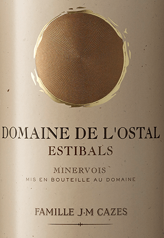 Domaine L'Ostal Cazes Estibals Minervois AOC by Domaines Cazes is named after one of the best vineyards in the estate: Estibals. With its deep red colour with violet reflections in the glass, the L'Ostal Cazes Estibals offers a rich bouquet with aromas of sour cherries, blackberries and red fruits, as well as scents of Mediterranean maquis. On the palate, this red southern French is full-bodied and soft with finely structured tannins and a hint of oak. Long, round finish. Cultivation and vinification of the Domaine L'Ostal Cazes Estibals Minervois by Domaines Cazes The Domaine L'Ostal Cazes is produced from the latest vines that do not meet the criteria for the production of the Grand Vin of L'Ostal Cazes. The cuvée consists of 42% Syrah, 36% Carignan, 12% Grenache and 10% Mourvèdre. The wine was aged for 12 months in French oak barrels. The balance of the different grape varieties makes this wine the best expression of AOC Minervois. Food recommendation for Domaine L'Ostal Cazes Estibals by Domaines Cazes This tasty red wine from the French Minervois goes perfectly with game dishes, dark and red meat as well as fine local cheeses. Wine Spectator Awards and Honours - 87 points (vintage 2012)