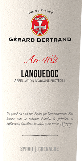 The Heritage 462 Languedoc by Gérard Bertrand appears in the glass in a deep dark red with violet reflections. The bouquet of this red wine seduces with the aromas of red and black berries, which are rounded off by liquorice, gingerbread spice and a hint of garrigue. The palate reflects the nuances of the bouquet and delights with its finesse and gentle tannins. Full-bodied, this vibrant cuvée blends into a long reverberation with the accents of roasted coffee and peppery spices. Vinification of the Gérard BertrandHeritage 462 Languedoc This cuvée is vinified from the Syrah and Grenache varieties. These grapes are harvested by hand at their optimum ripening times. They are then vinified separately in order to preserve the individual characteristics of the grape varieties. The Syrah grapes are macerated for about 15 days at low temperatures, the Grenache grapes are completely destemmed and macerated over a period of 3 weeks. After pressing and alcoholic fermentation, part of the wine is aged in French barriques for 10 months. Then it is blended with the other part to form a cuvée and bottled after a slight finishing. The Languedoc terroir is then left in the bottle for a few months to refine. Food recommendation for Gérard Bertrand Languedoc Enjoy this dry red wine with grilled meat and poultry, spicy pasta, braised eggplant or matured cheese.