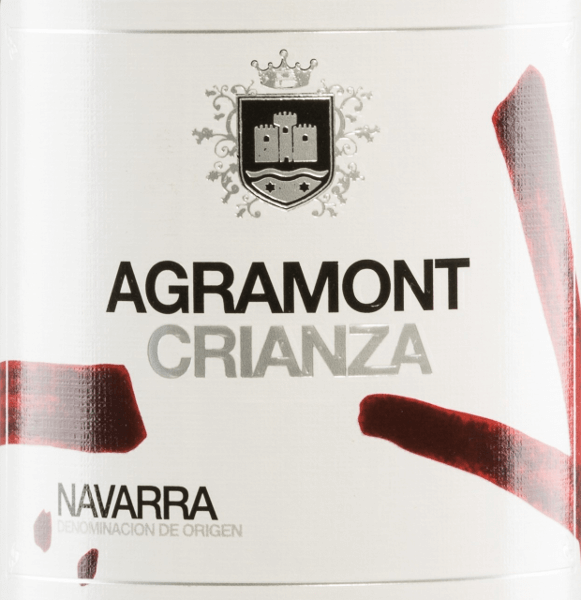 This Spanish red wine is a wonderful cuvée made from Tempranillo (40%), Cabernet Sauvignon (30%) and Merlot (30%) grape varieties. The Agramont Crianza from Bodegas Agronavarra wraps the glass in a brilliant ruby red. Strong berry aromas (blackcurrant, blueberry) as well as cinnamon and vanilla notes fill the nose. On the palate, a fruity, full taste is revealed, combined with gentle tannins. Vinification of Agramont Crianza After harvesting, the grapes of the Bodegas Agronavarra are destemmed and mashed. The resulting mash is fermented in a stainless steel tank and the resulting wine is aged for 12 months in American and French oak barrels. Food recommendation for the Crianza Agramont We recommend this red wine from Navarre with fish and seafood, meat dishes (lamb, kids, beef, pig), game and various hard cheeses. Awards for Agronavarra Agramont Crianza Mundus Vini: Silver for 2012