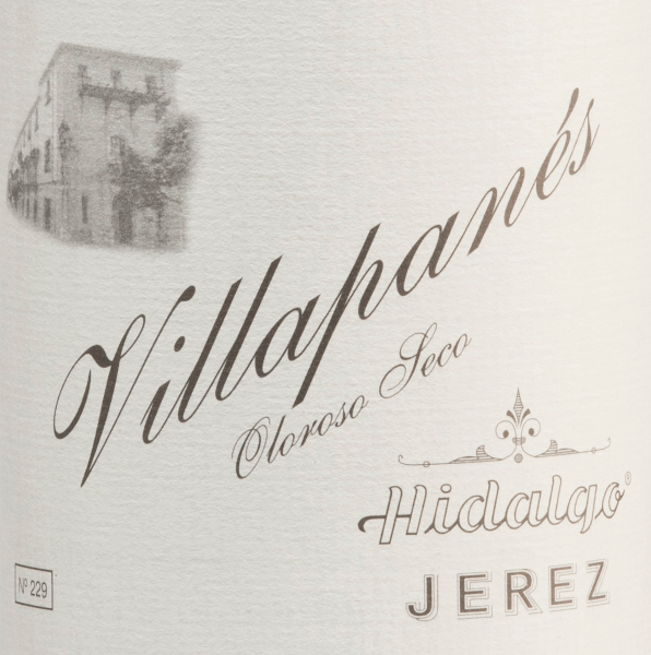 The Villapanés Oloroso Seco by Emilio Hidalgo comes from the Spanish D.O. Jerez region - a sherry that is exclusively vinified from the Palomino Fino grape variety. This wine was aged in French oak for almost 15 years. The glass shows an appealing mahogany colour with golden brown highlights. Despite the long barrel maturity, the bouquet is still fresh and elegant with aromas of walnuts, hazelnuts and walnuts, underpinned by a fine spice. On the palate, this sherry convinces with its profound, sustainable personality and a long-lasting reverberation. Vinification of Emilio HidalgoVillapanés Oloroso Seco The grapes harvested by hand are destemmed, gently pressed and the must produced therefrom is fermented in a temperature-controlled manner in a stainless steel tank. This young wine is then drawn off, sprayed on and placed in American oak barrels for the first ripening. The barrels are filled only to a certain extent (maximum 85%), so that the characteristic pile (a yeast layer) can develop, which seals the wine airtight and gives it the sherry-specific aroma. After maturation, this wine is transferred to the traditional Solera system, in which sherries of the same type are aged in barrels arranged one above the other for three to ten years. The oldest wines are stored in the lower barrels (Solera), while the youngest wines are stored in the upper rows (Criaderas). The sherry intended for sale is always removed from the lower barrels. In this case, however, only a small part (a maximum of one third) is removed and the removed part is then filled up by sherry from the upper rows. The whole principle continues to the uppermost barrels, where young wine, the Mosto, is added to the sherry. Food recommendation for the Villapané HidalgoOloroso Seco This sherry from Spain is a wonderful soloist, slightly chilled. But also with strong stews (as with grandma) or spicy hard cheeses a very good choice. Awards for the Villapanés Oloroso Seco by Emilio Hidalgo Vinum: 18,5 points 